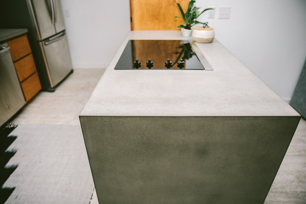 Concrete Waterfall Countertop - Opus Artisan Concrete - Design By Modern Beach House Designs