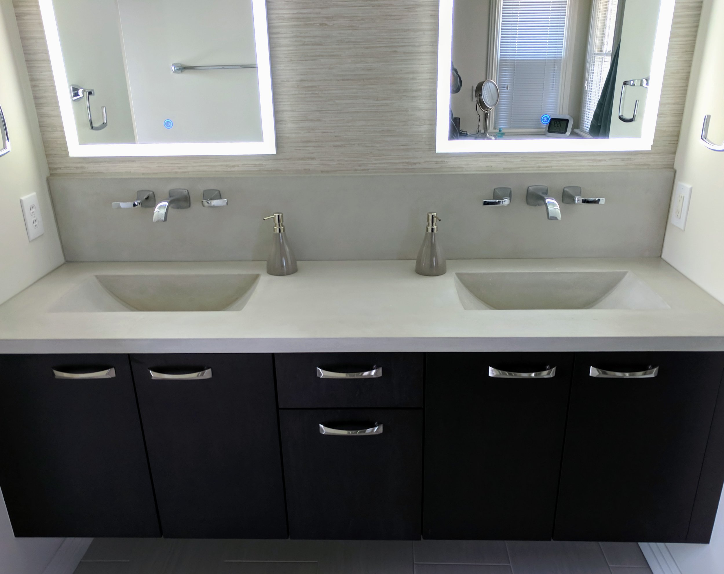 Floating Vanity withIntegral Barrel Sinks - Design by Premiere Coastal Contracting -Cabinets by Cozy Kitchen Group