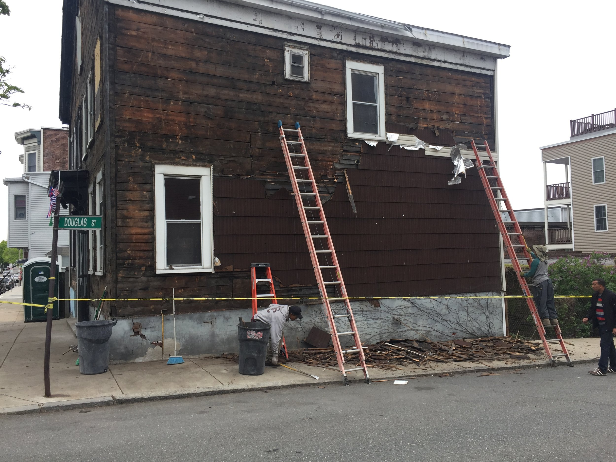 As you can see, there were multiple layers of siding we had to strip off.