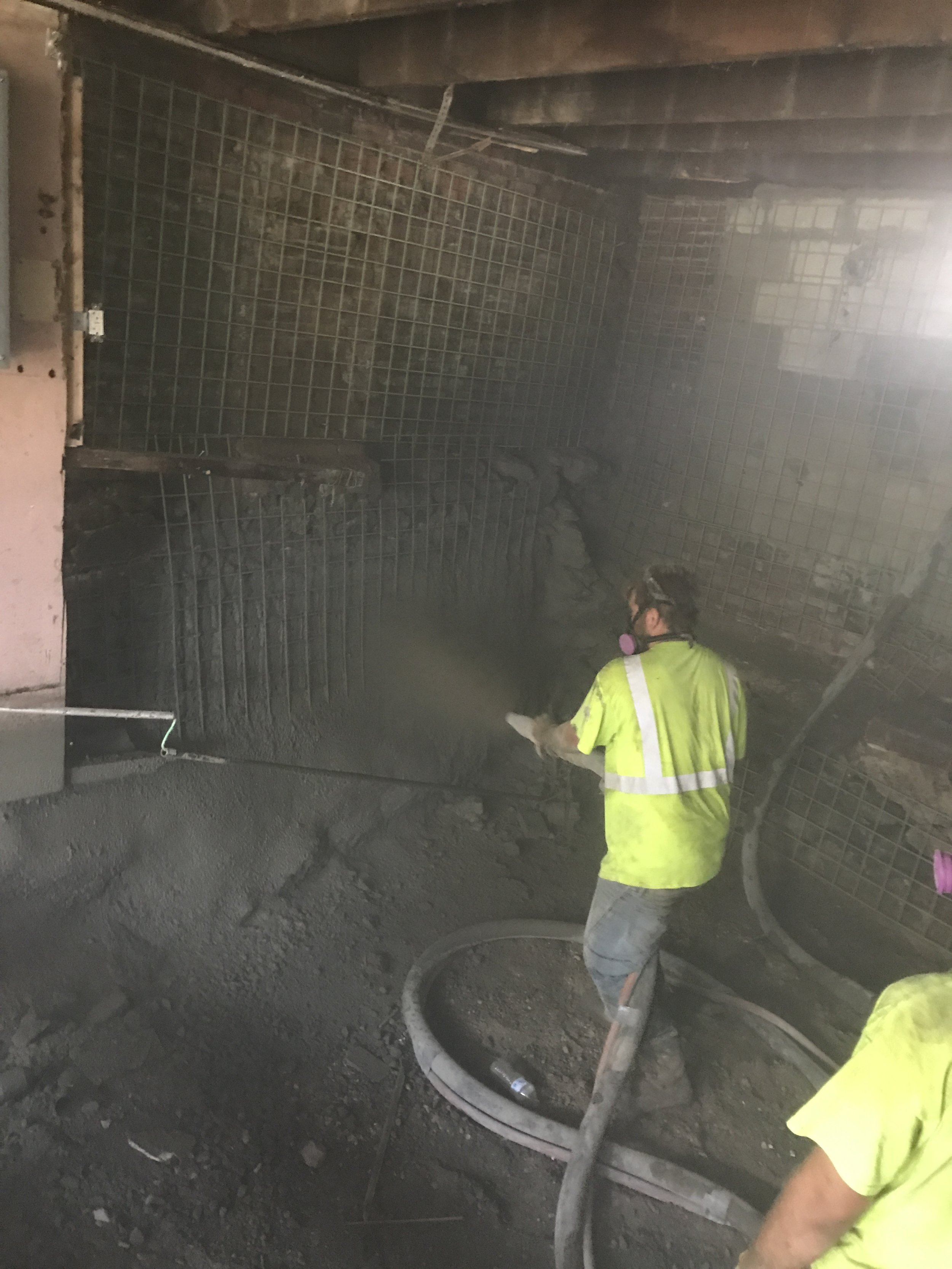 Our expert team in action spraying the shotcrete. Shotcrete is typically used in commercial applications such as Sea Walls and Subway stations due to its strength and longevity.
