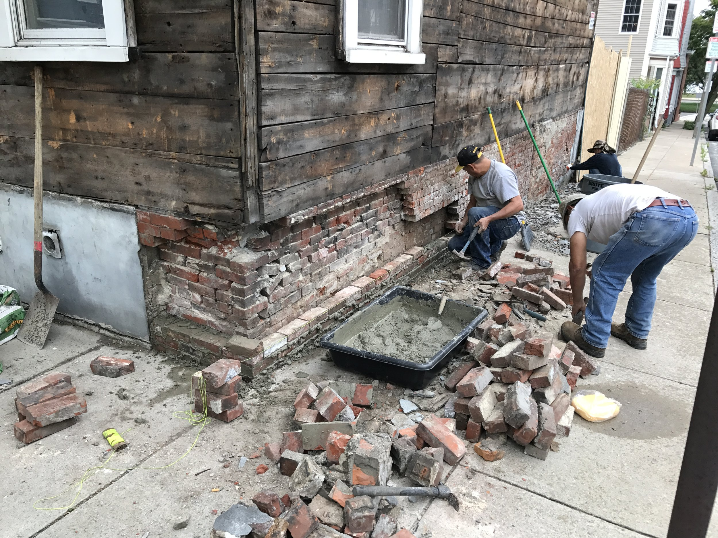 Now that the inside of the foundation is secure, its time to take down and rebuild the exterior brick.