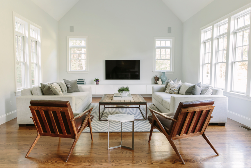 Hardwood floors and white walls make this living room with transitional modern furniture feel open and spacious.