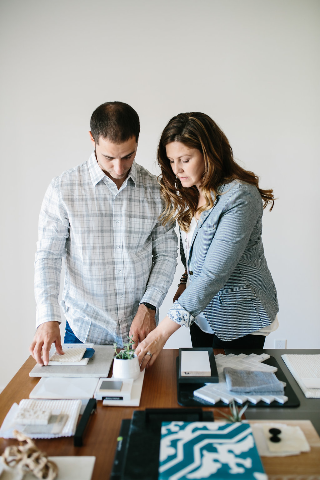 Husband and wife working on a couple of design projects.