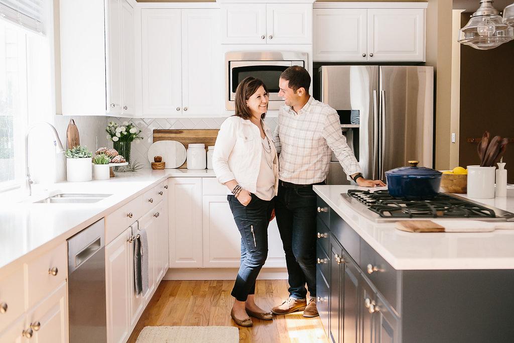 Interior designers and Decorators John and Sherri Monte standing in a new kitchen design.