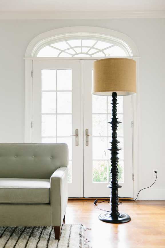 Modern sofa with linen lamp and shade.
