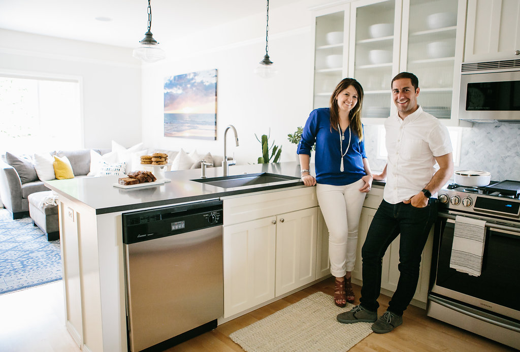 Interior Designers (John and Sherri Monte) standing in a space they designed