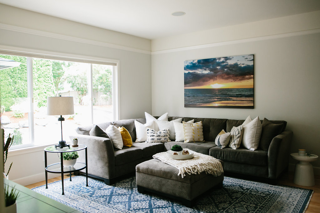 Sectional sofa in living room with decor.