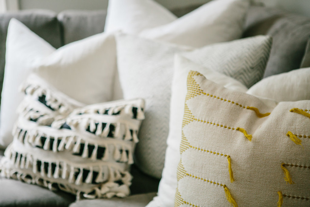 Throw pillows of varying size and shape.