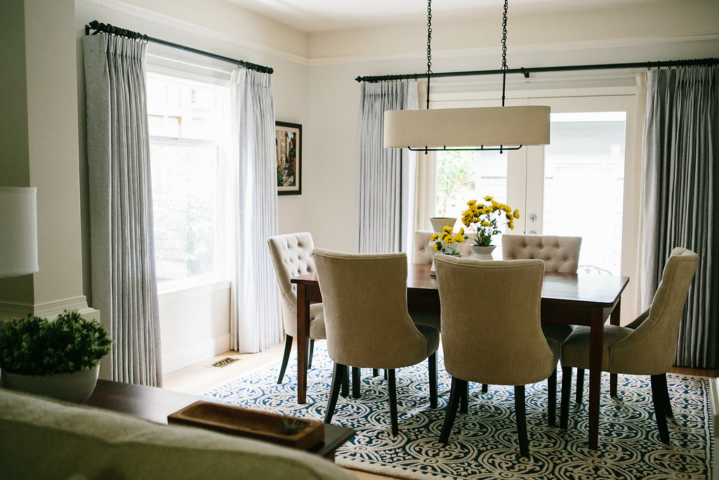 Dining room with chandelier and dining rug.