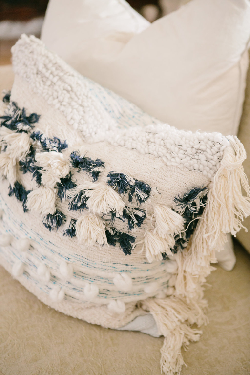 Textured throw pillows with navy, turquoise and white.