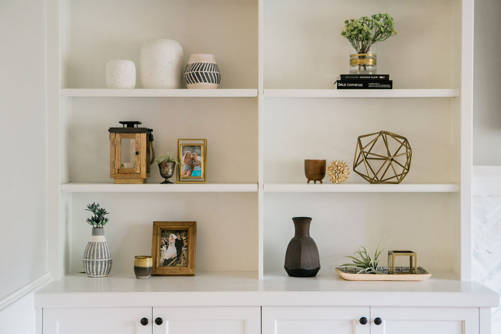 Styled bookcases accessorized by an interior designer and decorator for a clients home.