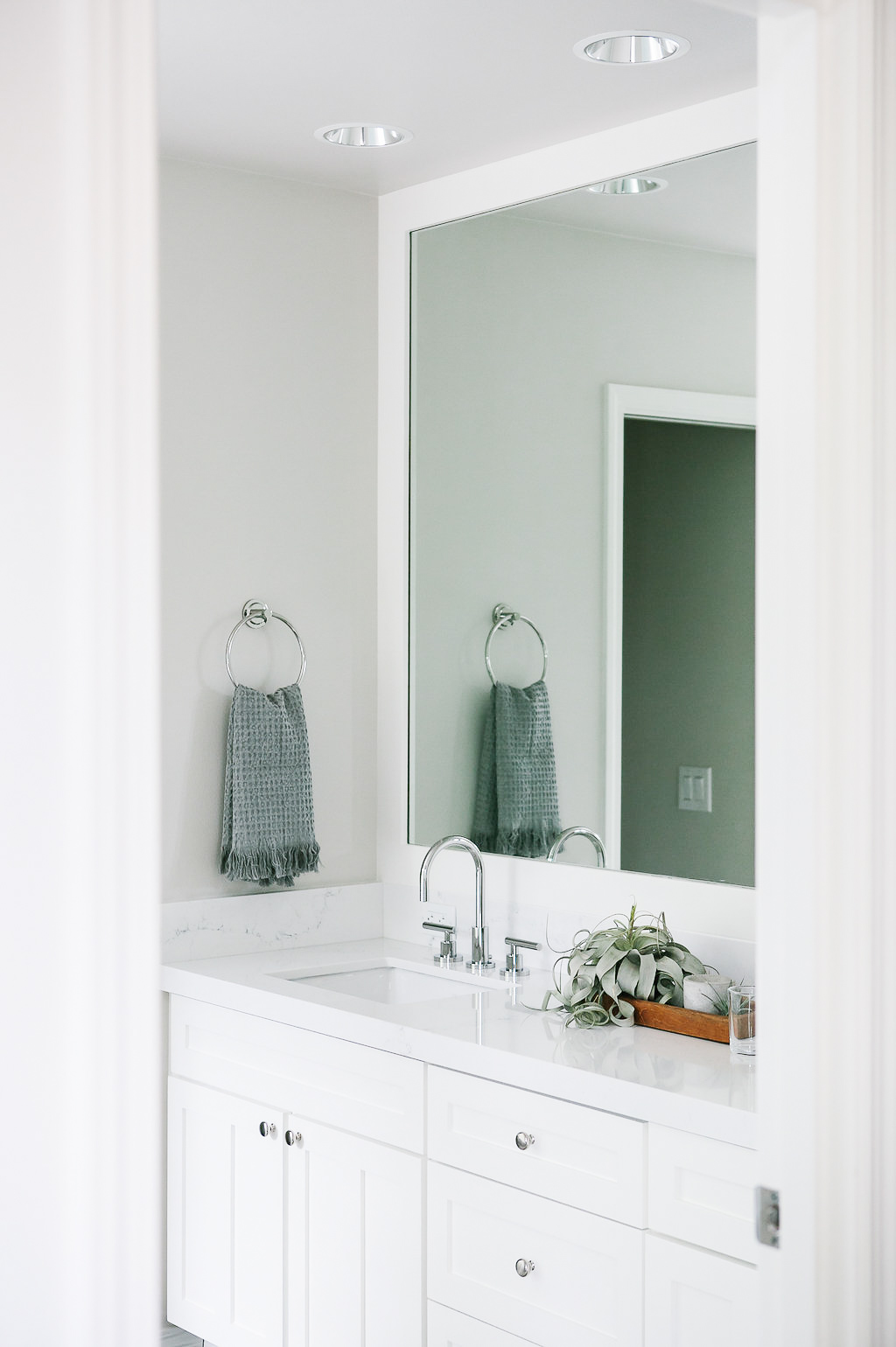 White master bath double vanity with under mount sinks.