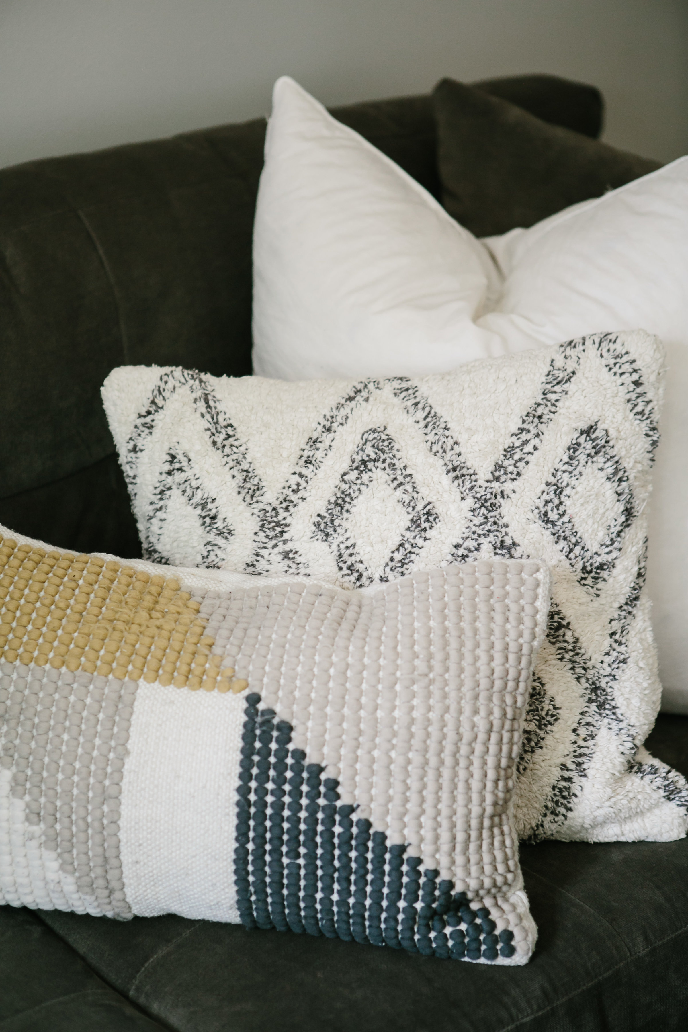 Throw pillows on a large crate and barrel sectional.