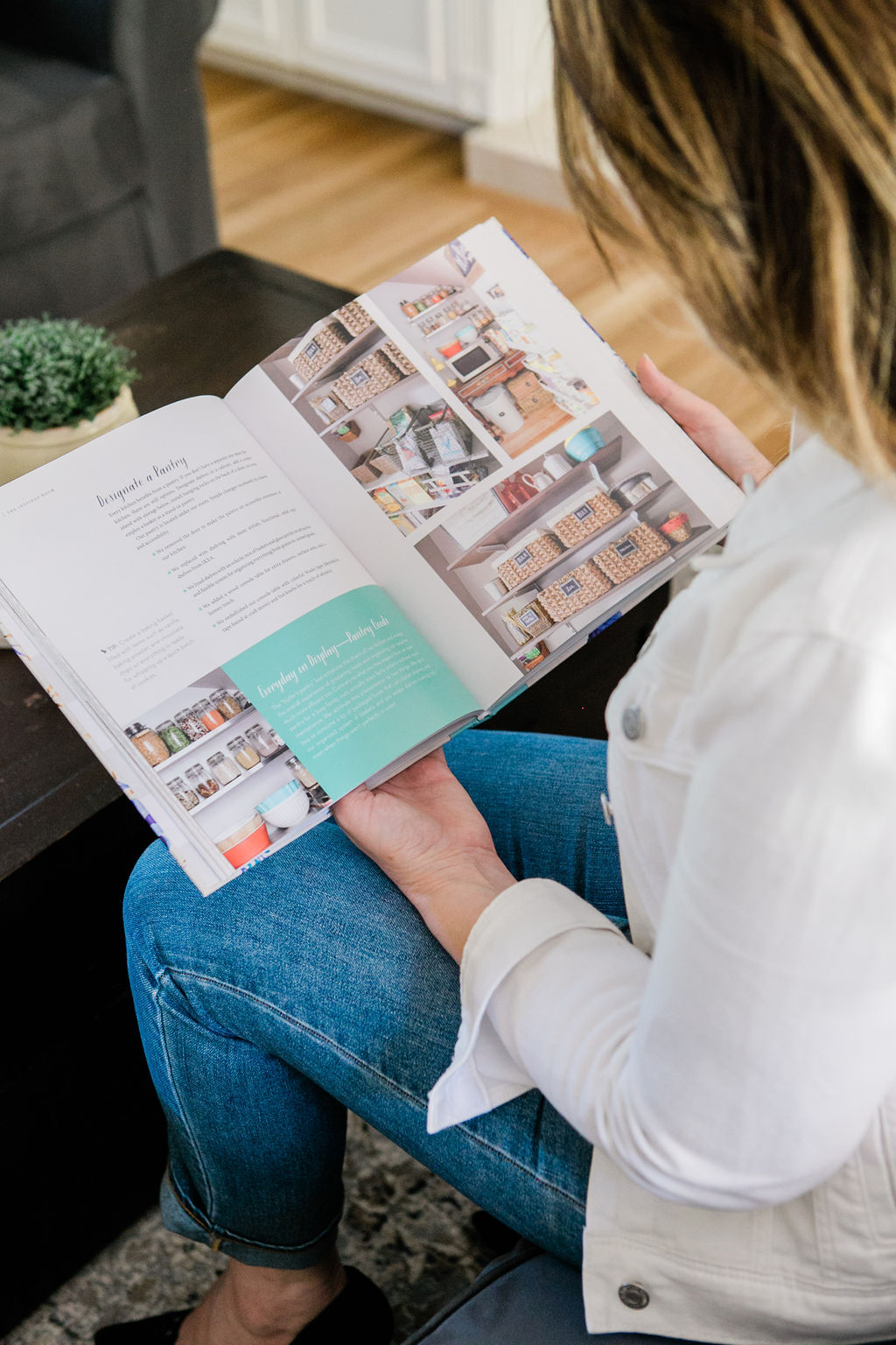 Sherri Monte, an interior designer and home organizer reading an organizing ideas magazine.