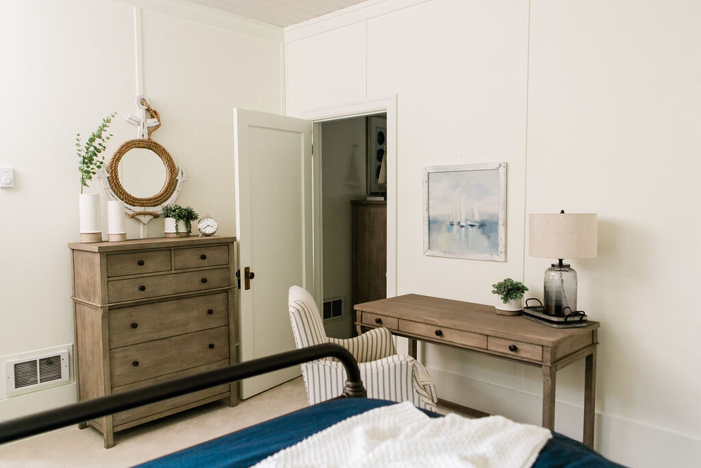 A Weathered gray dresser and desk compliment the home's surroundings.