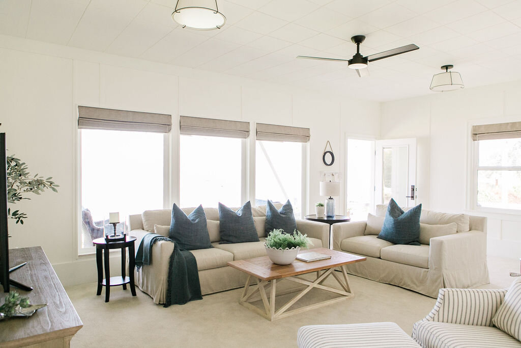 A beach cabin with pottery barn sofa's and coastal blue tones.