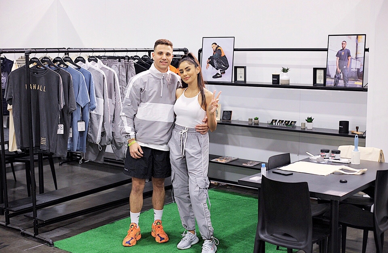 Tyler Bowman and his fiancee, Daiana, in their M A N A L L booth at the Agenda Show