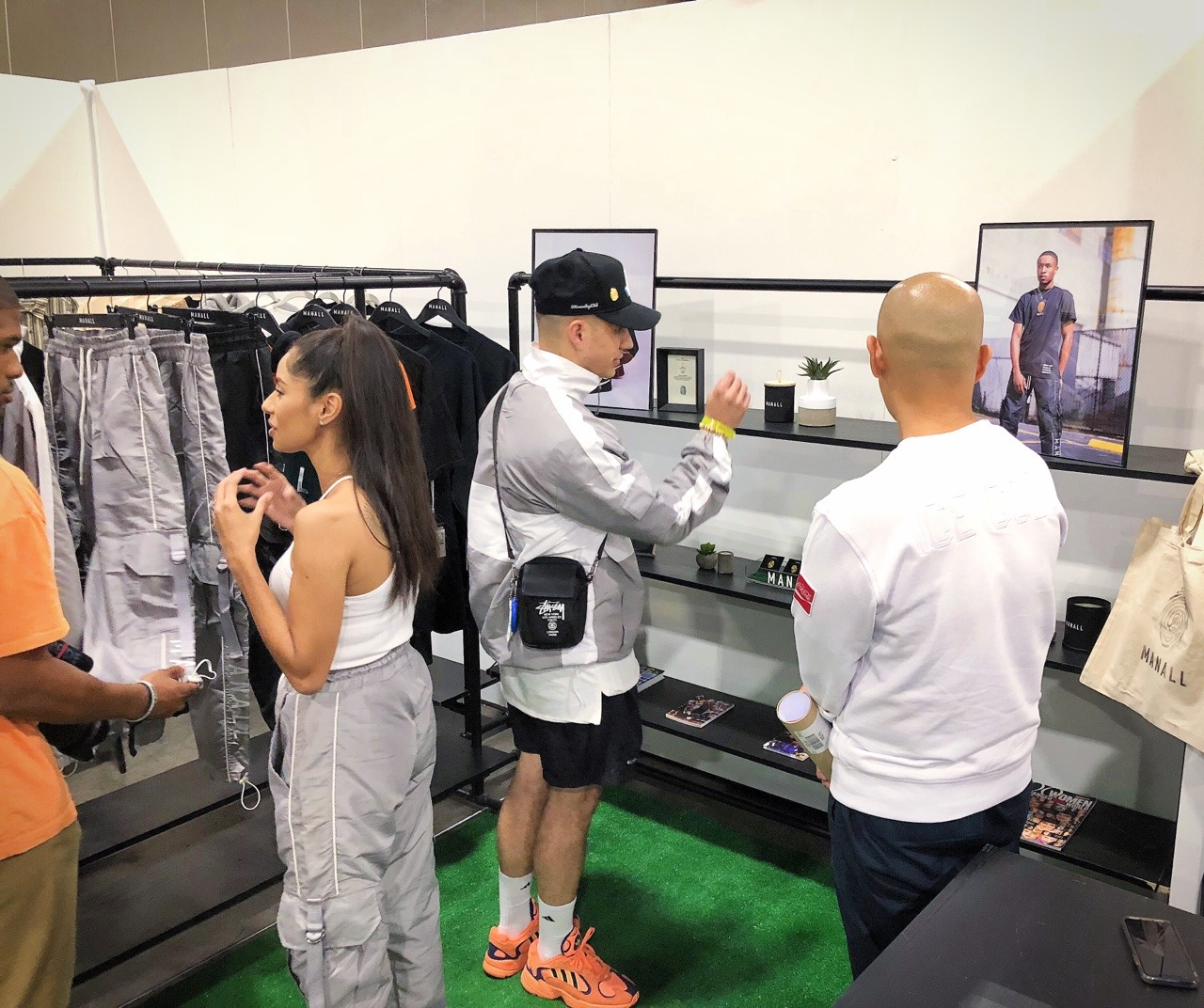 Jeff Staple (far right) chats with Tyler in the M A N A L L booth
