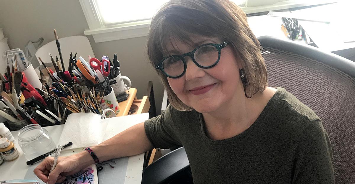 Illustrator Jean Ruth at her desk (Image courtesy of the artist)