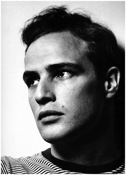 Ask your subject to turn towards the light to capture interesting highlights and shadows.  Marlon Brando , Phillippe Halsman, 1950 ( image source )
