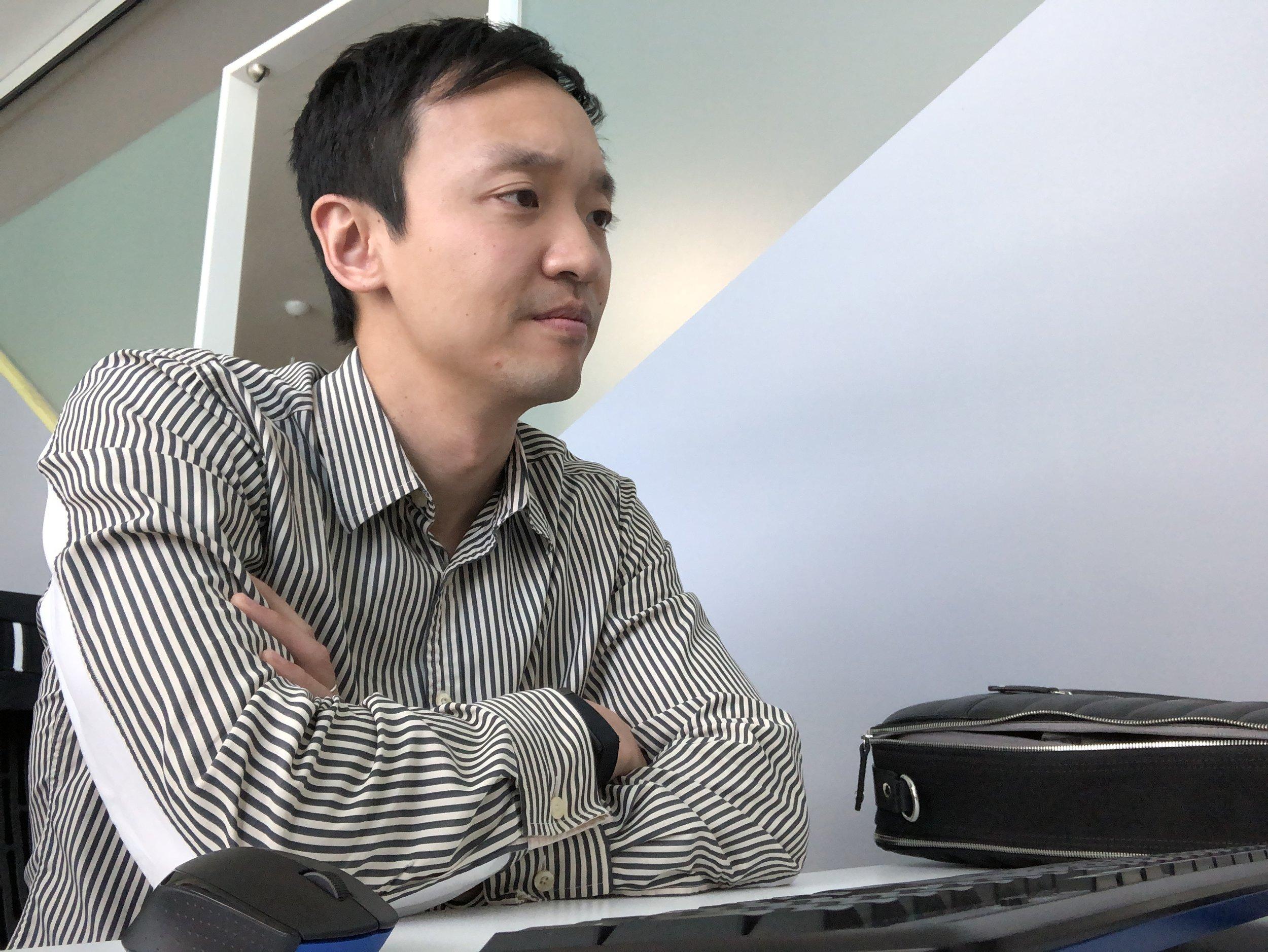 John Kim, pictured, video editing at his desk (image courtesy of John Kim)