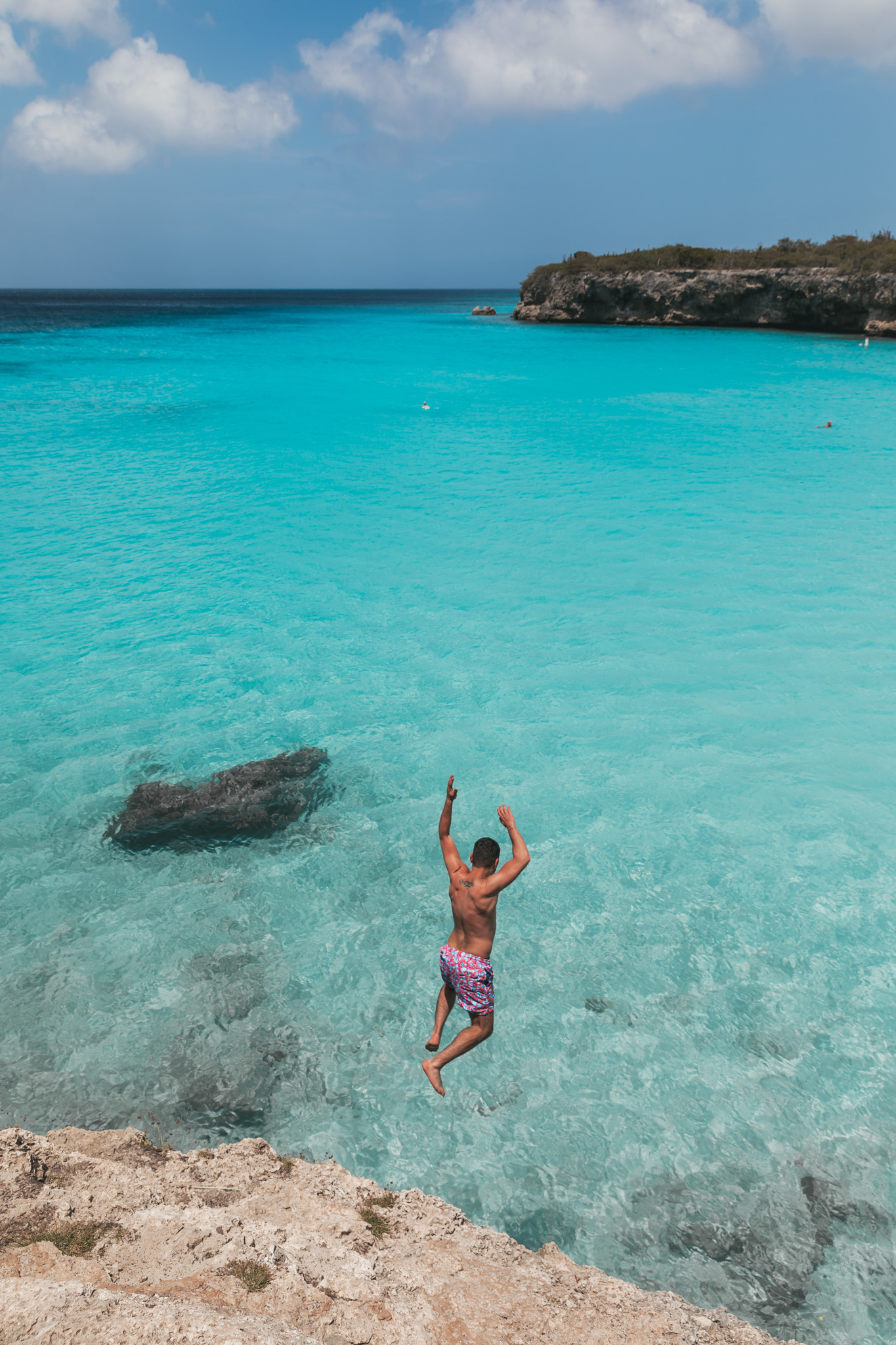 Cliff jumping at Playa Knip on Curaçao // 20 Photos to Show You Why Curaçao Needs to Be On Your Travel Radar // www.readysetjetset.net #readysetjetset #curacao #caribbean #beach #ocean #paradise #travel