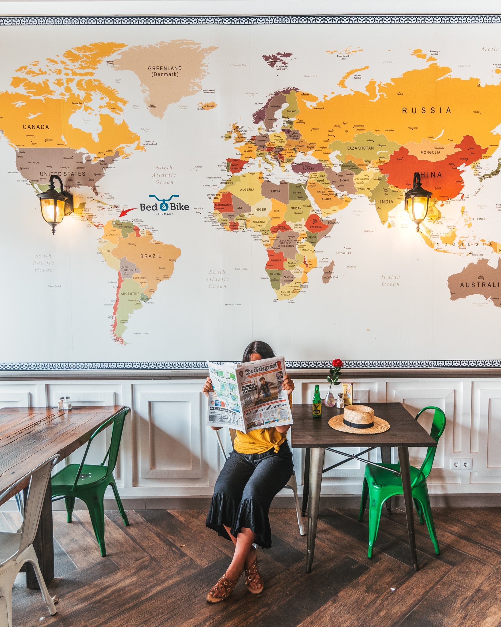 A cute cafe with a map on the wall in Willemstad, Curaçao // 20 Photos to Show You Why Curaçao Needs to Be On Your Travel Radar // www.readysetjetset.net #readysetjetset #curacao #caribbean #beach #ocean #paradise #travel