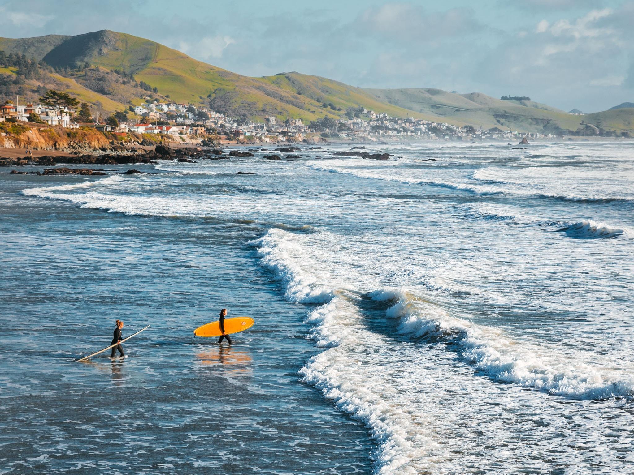 Surfer girls on Cayucos Beach // 5 Adventurous Things to Do in San Luis Obispo County #readysetjetset #surfing #slocal #travel #blogpost #adventuretravel #california #westcoast