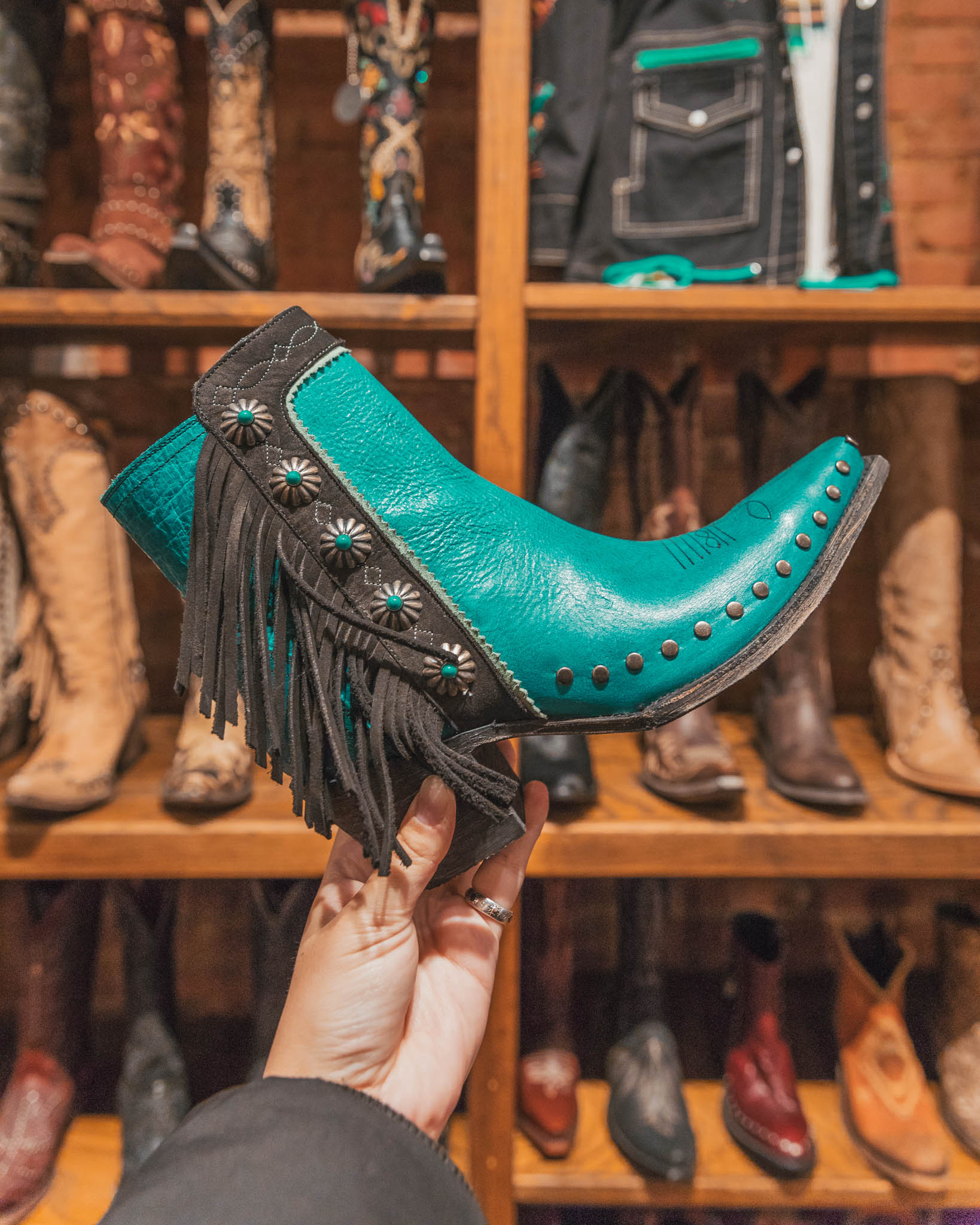 Cowboy boot shopping in the Fort Worth Stockyard for teal boots