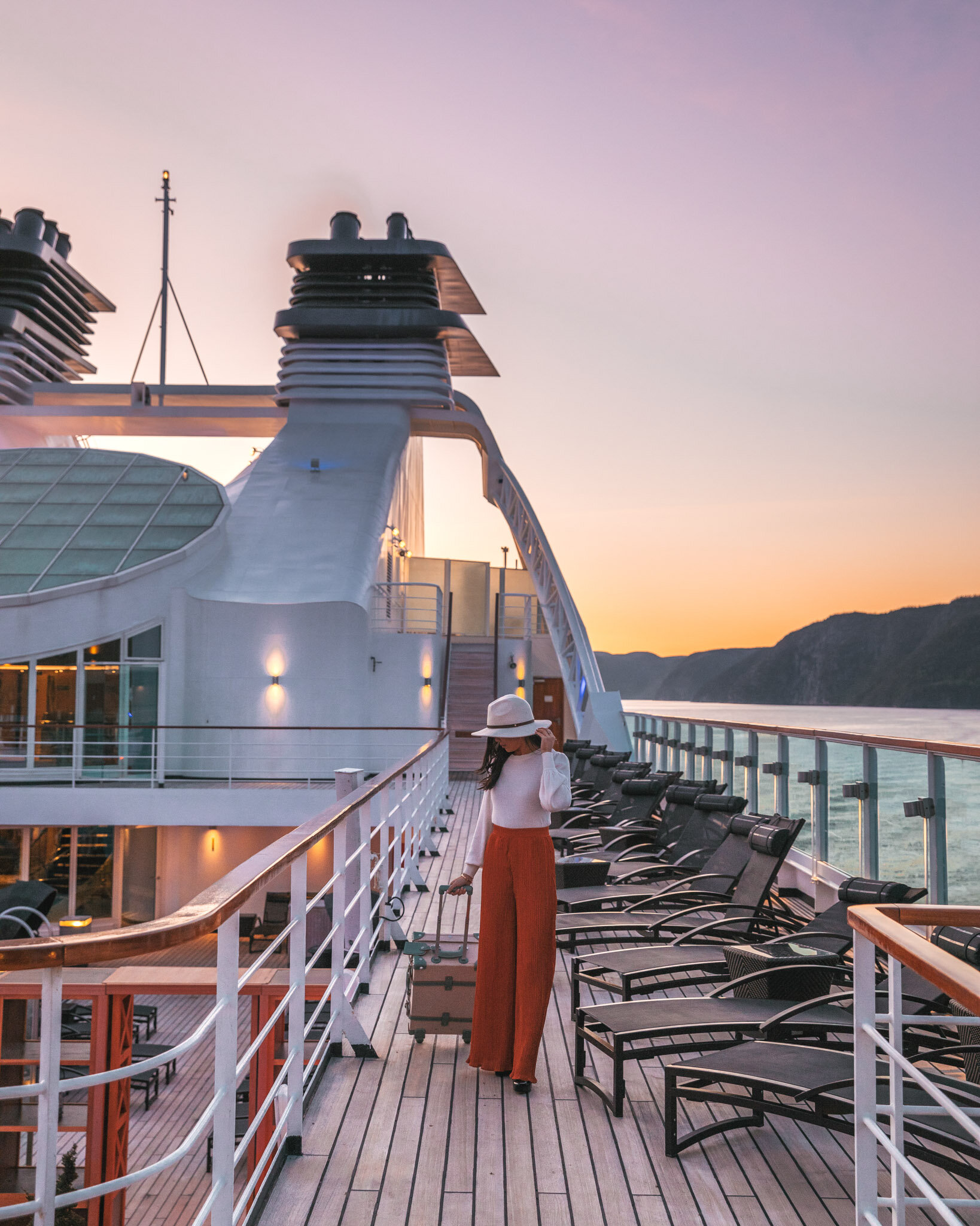 Seabourn Quest at sunset on the Saguenay Fjord in Canada // Cruise Review: 11-Day New England & Canada on the Seabourn Quest // #readysetjetset #canada #cruise #luxury #travel #cruising