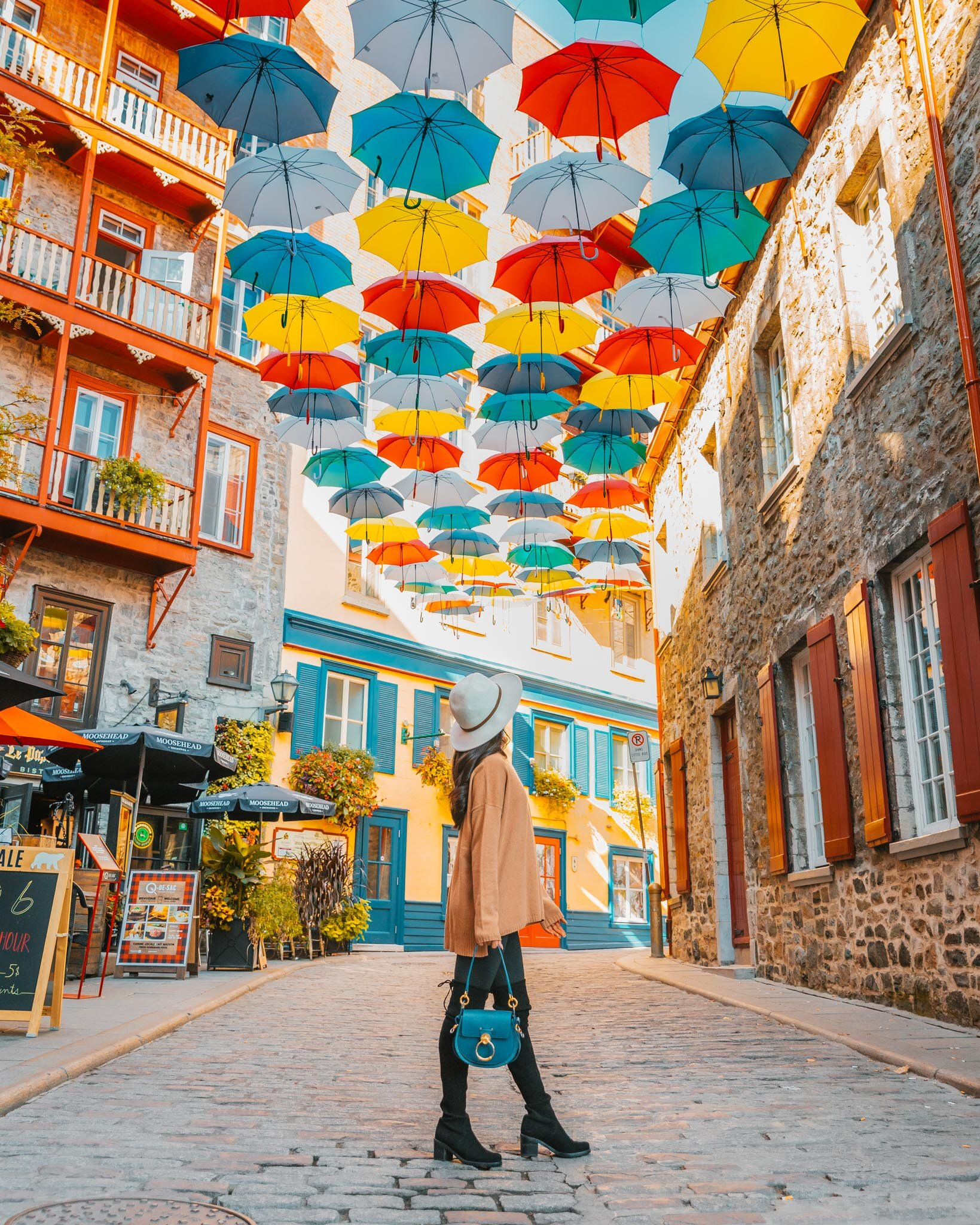 Quebec City umbrella street in Old Town // Cruise Review: 11-Day New England & Canada on the Seabourn Quest // #readysetjetset #cruise #luxury #travel #cruising #canada