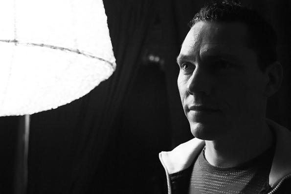 12 Tiesto poses for a quick portrait backstage before his set.jpg