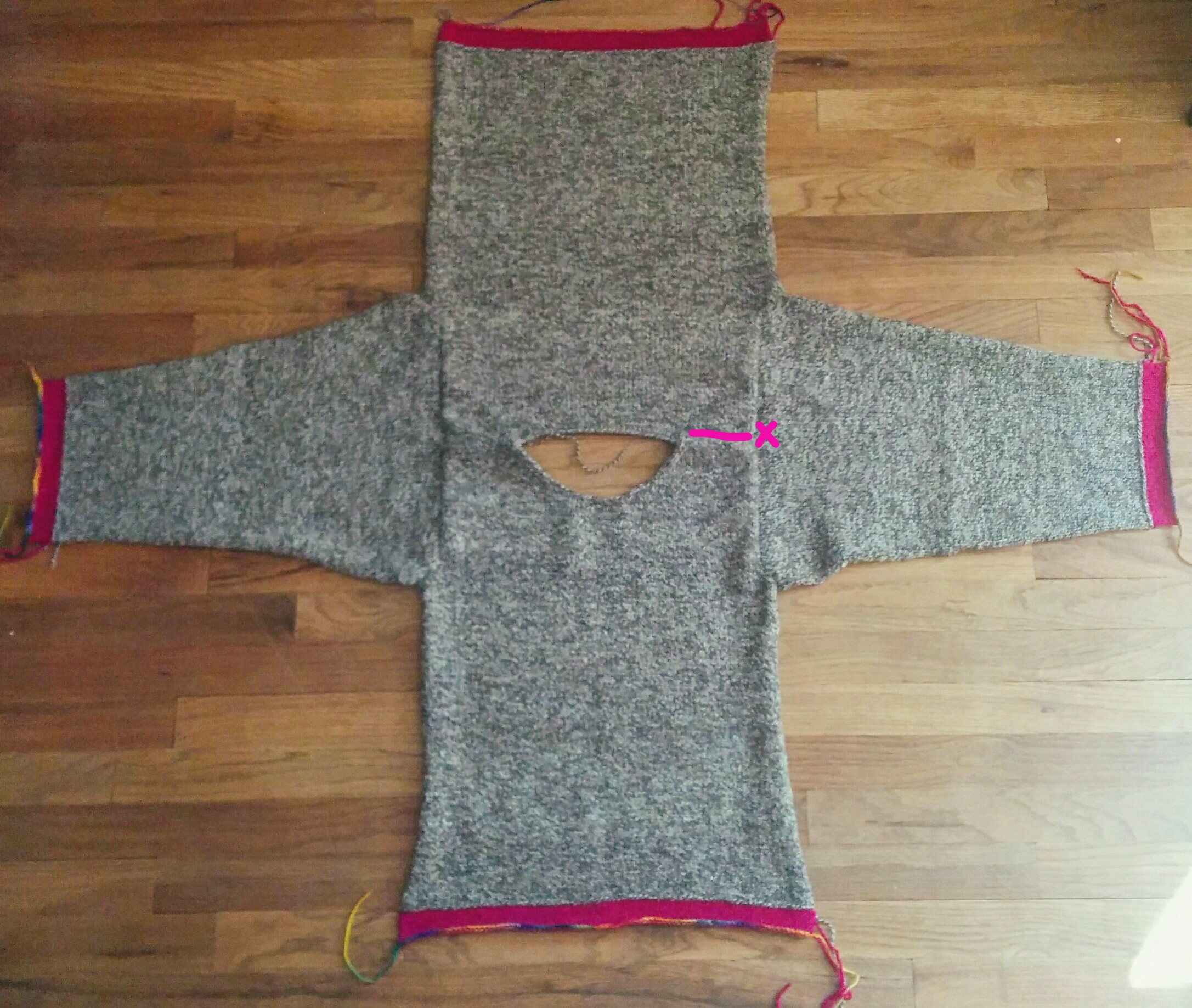 (In this blurry floor photo, the sleeves have already been sewn on, but you get the idea re: placement.)