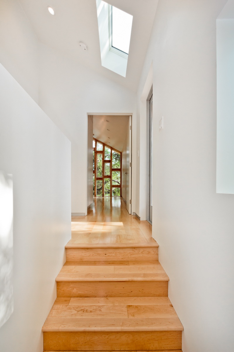 A view at the top of the stairs looking into the master bedroom.