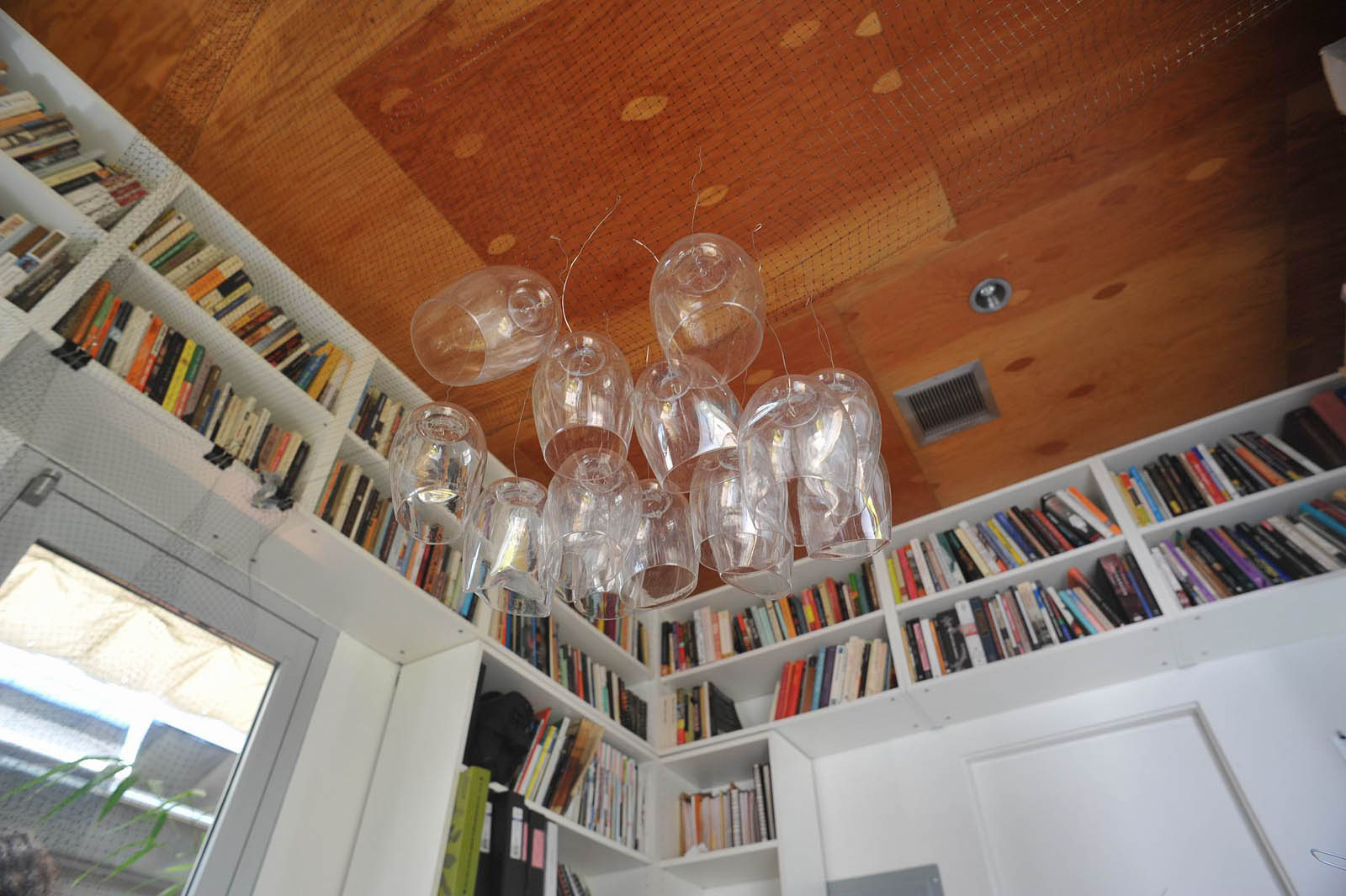 This is the beginning of our investigation with discarded plastic wine glasses as seen suspended from a net hung from our office ceiling.