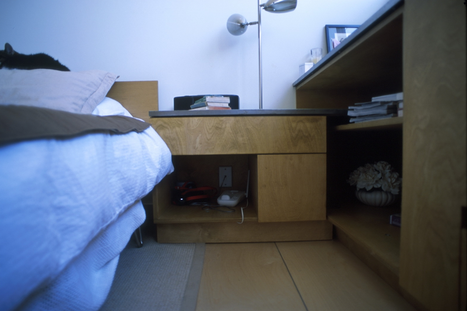 A nightstand is provided as the terminus of the installation.