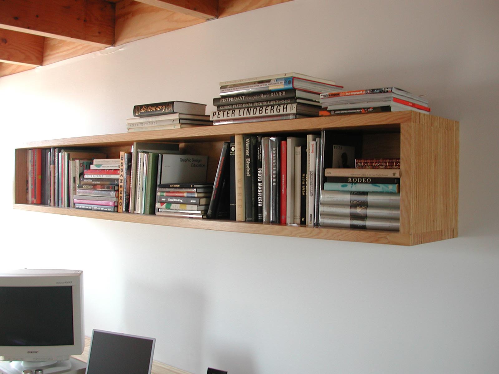 The wall-mounted bookshelf.