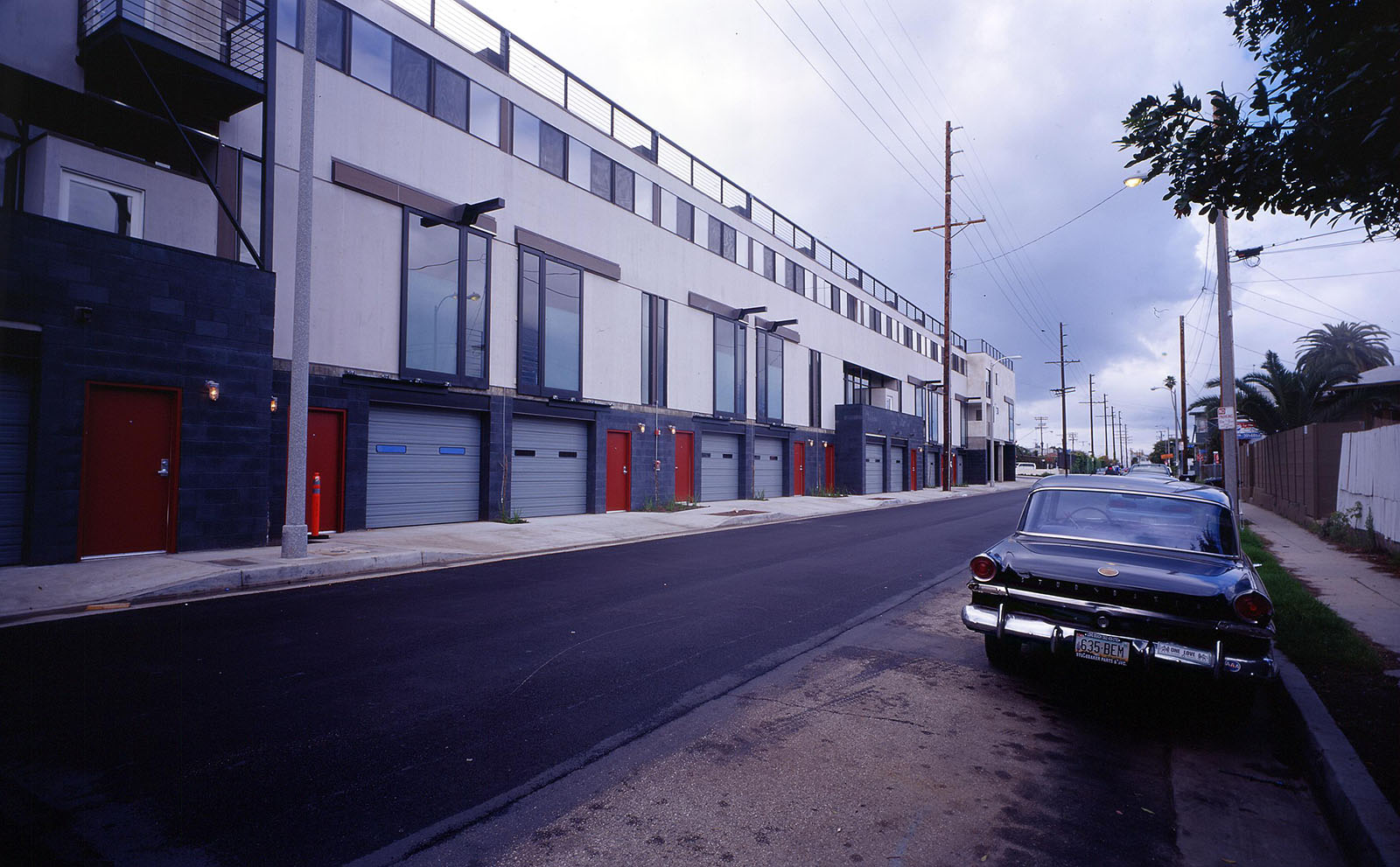 This is a 16 unit live-work condominium development in Venice, CA. This view is looking North on Electric Avenue.