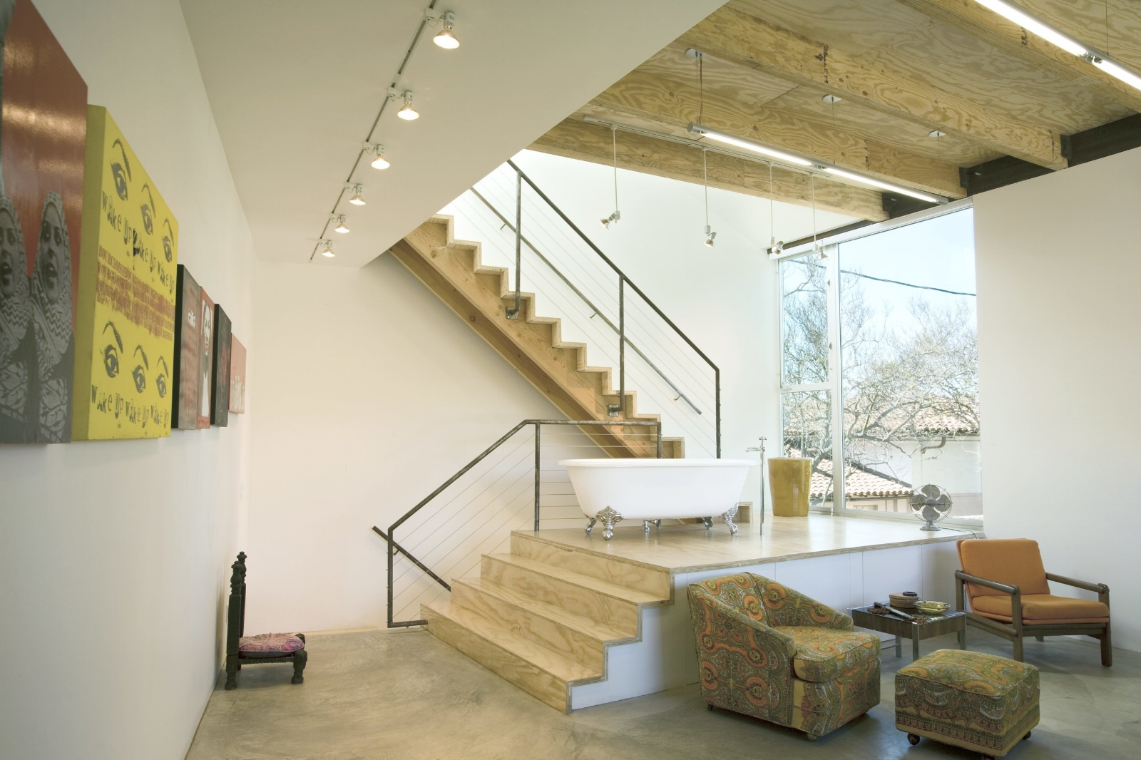 Interior view of the studio showing the stair access to the roof deck.