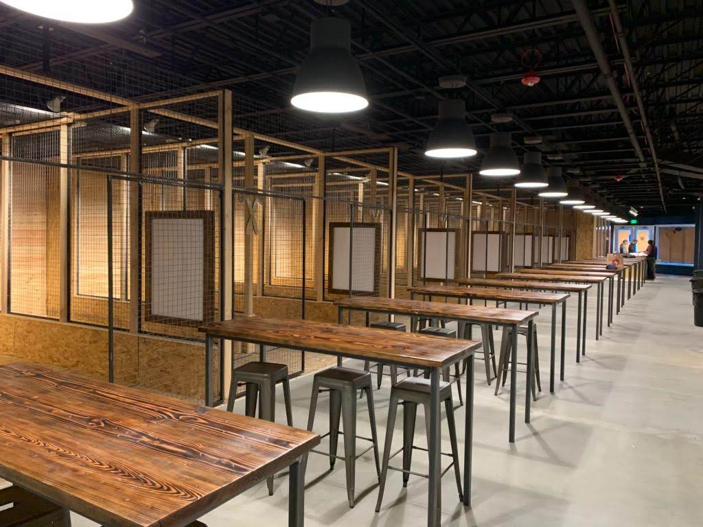 A view of some of the 18 axe throwing lanes and the seating area which can accommodate close to one hundred people