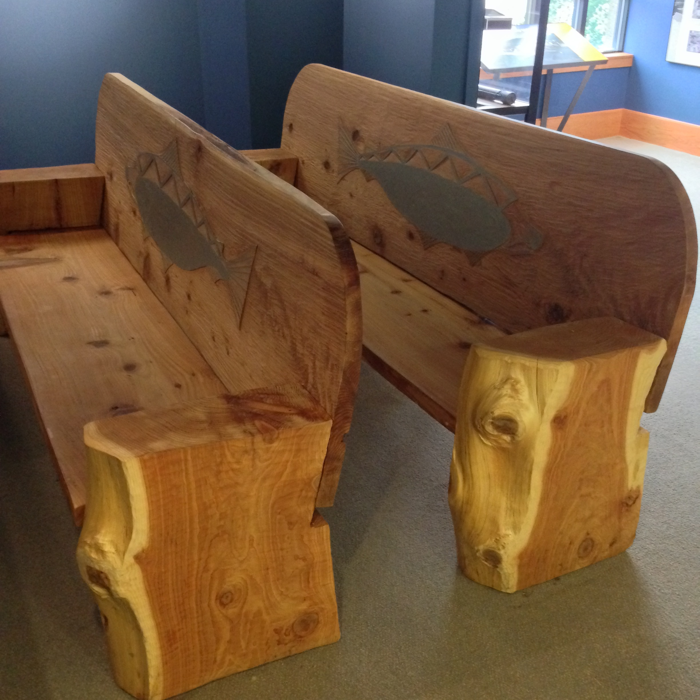 Sit on hand-carved benches while enjoying short films on the Willamette Falls (benches gifted by the Confederated Tribes of the Grand Ronde).