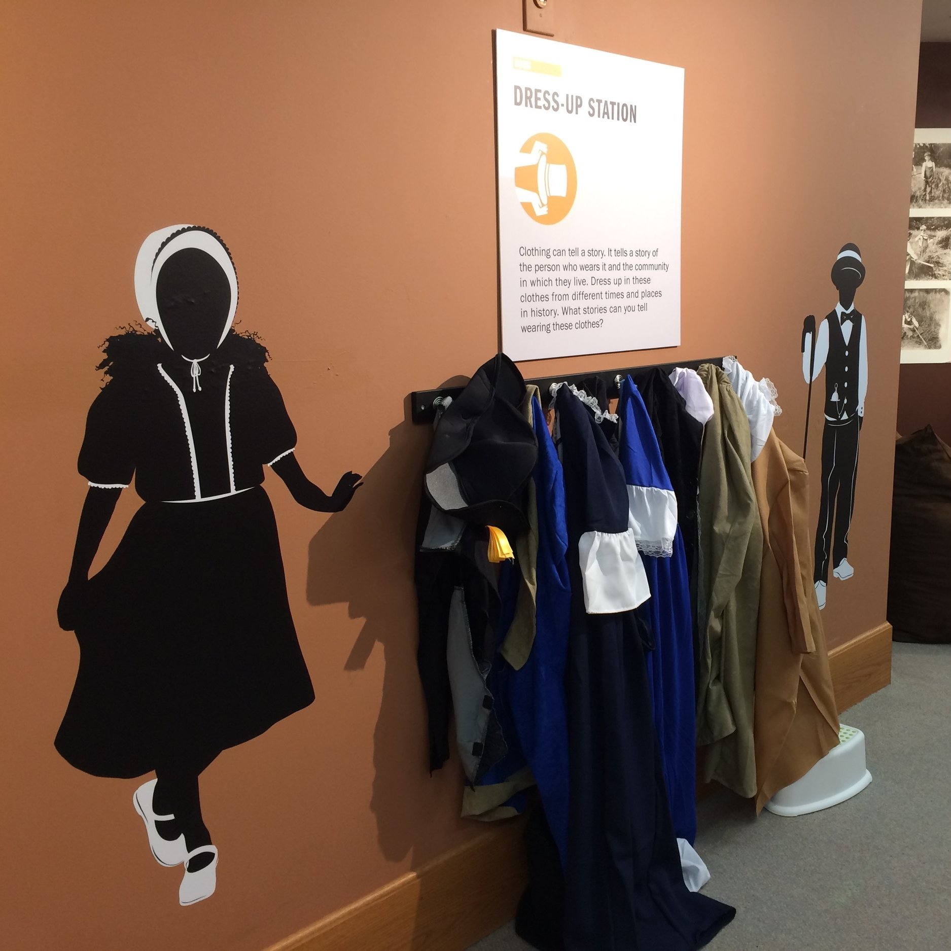 A dress-up station allows younger visitors to step into the fashions of early Oregonians.