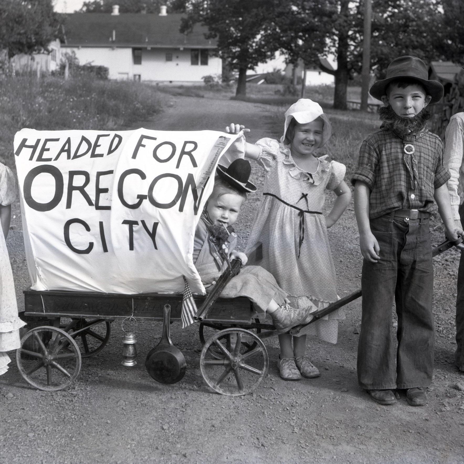 Children leading mock-Pioneer Wagon (Cropped)