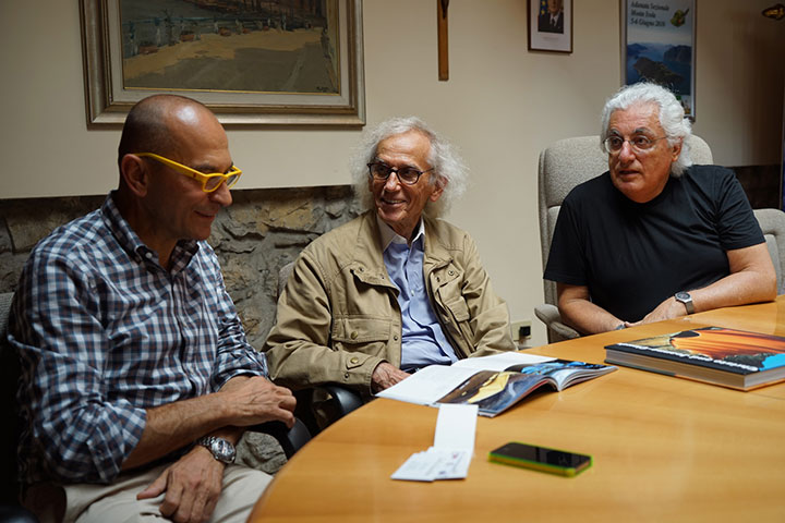 Christo and project director Germano Celant introduce The Floating Piers project to Fiorello Turla, mayor of Monte Isola, August 2014