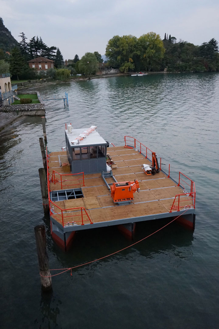 The floating platform will be used to position anchors on the bottom of the lake to keep the floating piers in place