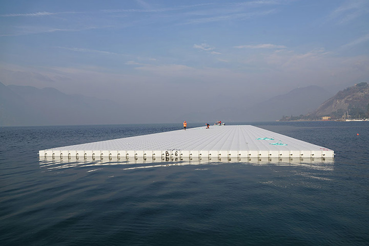 One of the 100-meter-long segments is towed to the temporary storage on Lake Iseo, January 2016
