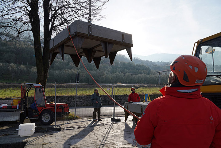 One of the anchors that will keep the piers in place is lifted into the water of Lake Iseo, January 2016