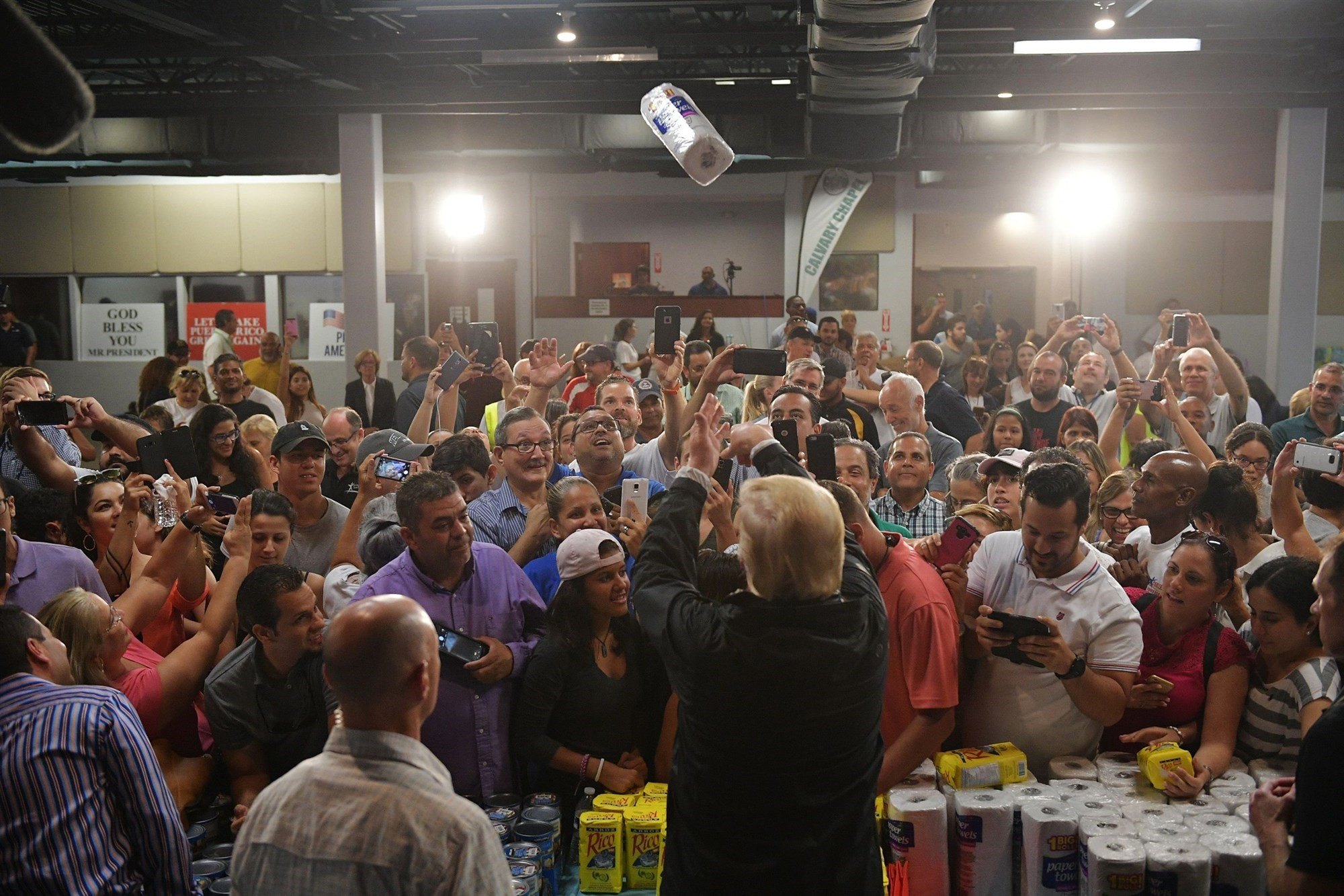 Trump throws a roll of paper towels at a press conference in Puerto Rico following the hurricane - NBC