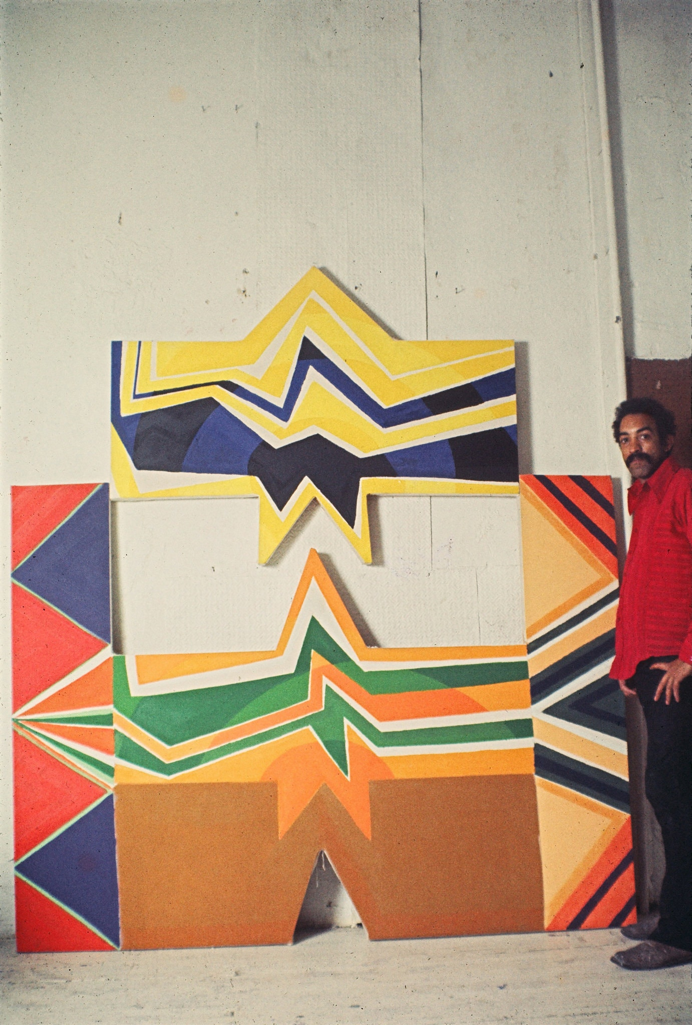 "Joe Overstreet with his painting ""North Star"" (1968). Joe Overstreet/Artists Rights Society (ARS), New York, via Eric Firestone Gallery, New York. - The New York Times"