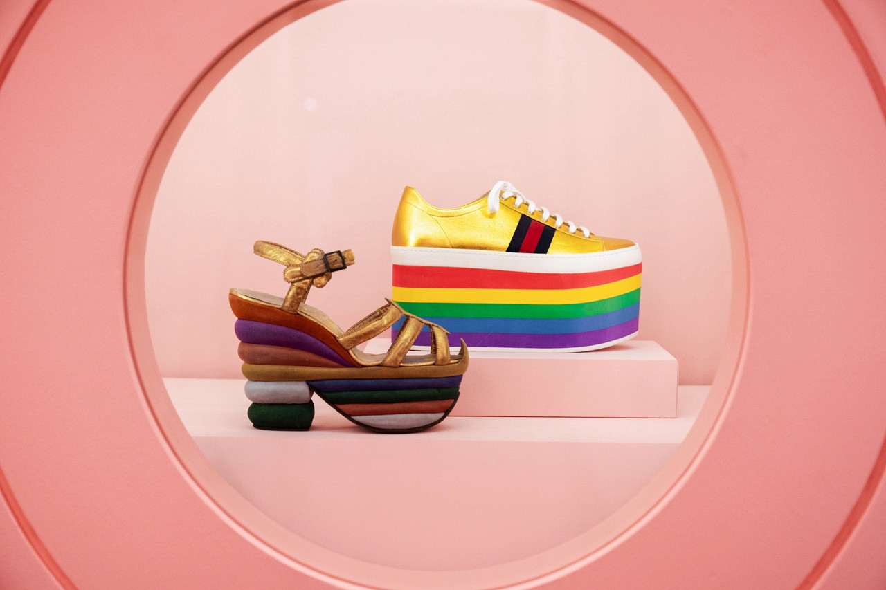 Salvatore Ferragamo's rainbow platforms alongside Gucci's rainbow sneaker. | Metropolitan Museum of Art